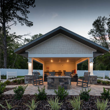 Covered community pavilion with fire pit
