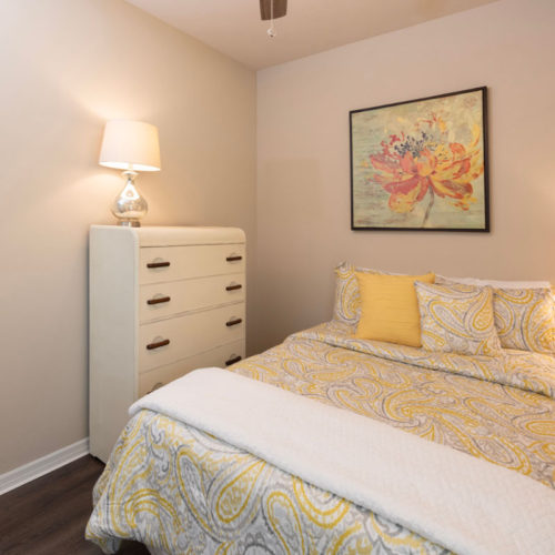 Bright furnished bedroom. with bed made.